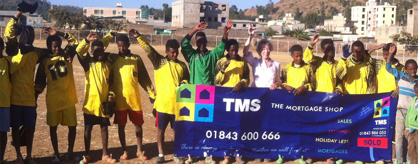A fantastic picture of some happy boys in Ethiopia wearing a football kit that the Mortgage Shop donated